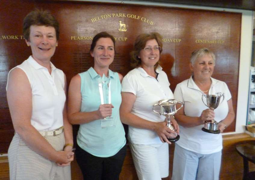 Belton Park lady captain Sheila Mason presents the trophies to Vicky Grindal, Anna Clark and Yvonne Bashford (from left to right).