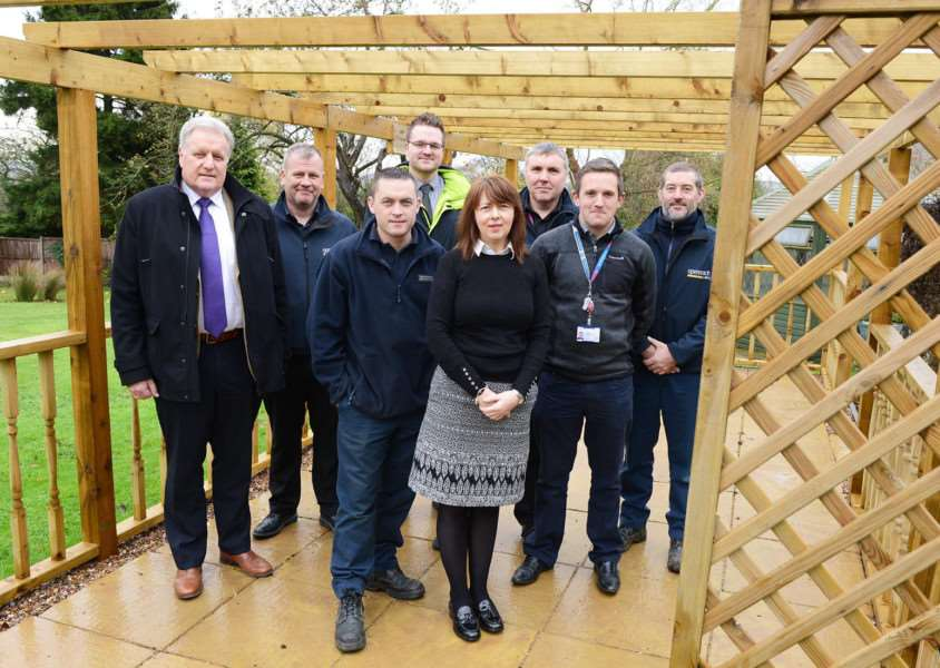 Tina Dingley is pictured with volunteers from BT Outreach and Turnbull & Co Sleaford under the new pergola.