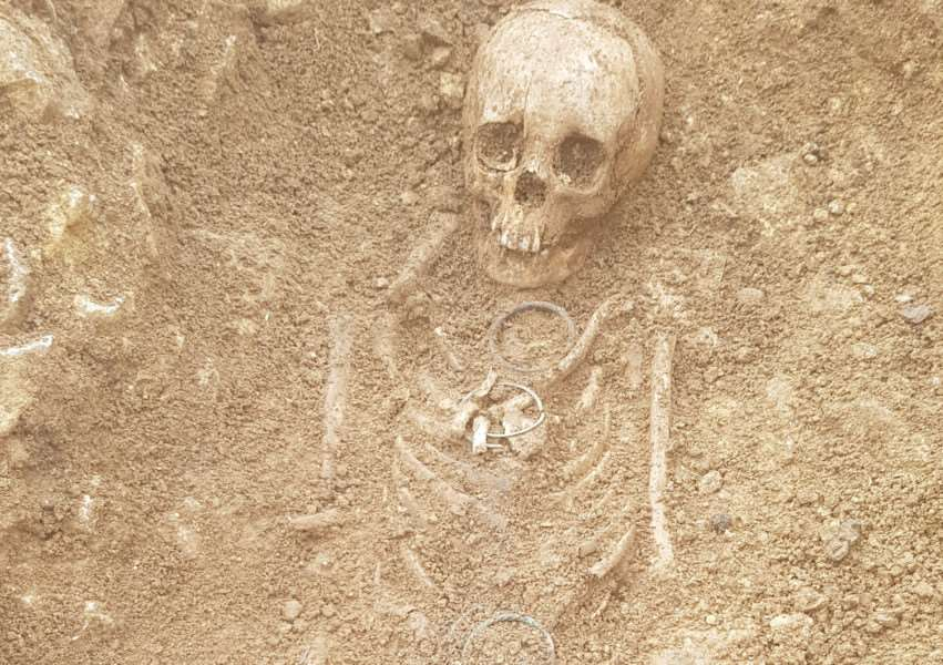 A Roman female burial, with copper-alloy bracelets and part of a pottery vessel. She was buried on an east-west alignment which suggests Christian tradition, putting her around the mid 4th century AD.