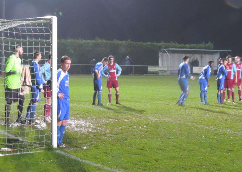 Harrowby United defend a corner kick at Deeping Rangers.