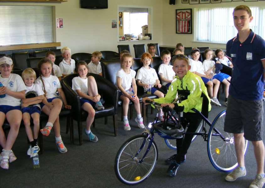 Disabled athlete Thomas Talbot and young triathlete Chris Davies talk to children about how to get into sport. EMN-150307-152402001
