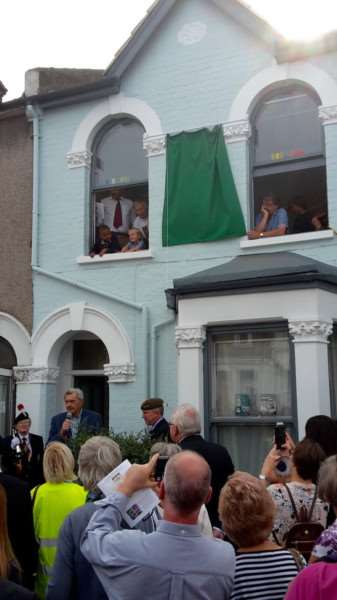 The unveiling of the blue plaque at the former home of young war hero Sidney Lewis.