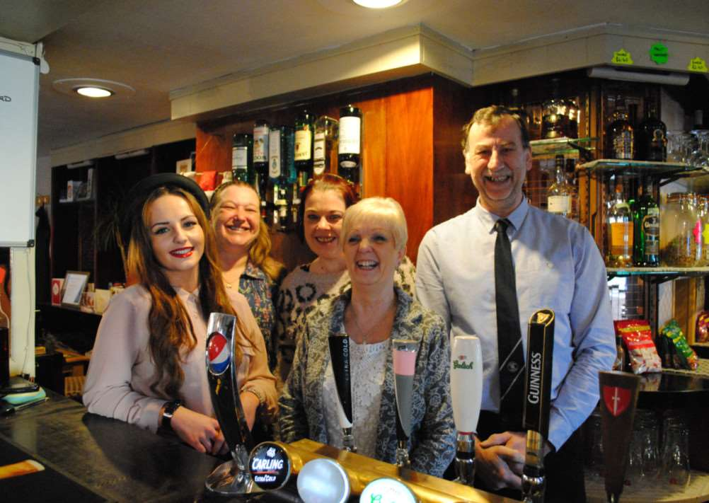 Celebrating their Best Bar 2014 award at the Lord Harrowby are, from left, bar staff Kirsty O'Shaughnessy, Trudi Clark, Kelly Richardson and licensees Lynda and John Senior. Photo: 0294A