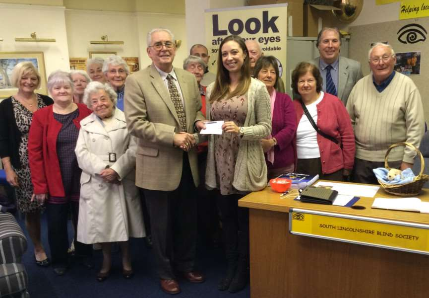 A �500 cheque being presented to the South Lincolnshire Blind Society on behalf of the Freemasons to Andrea Meads, Services Team Leader of the Charity.