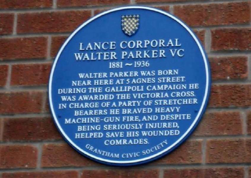 A blue plaque dedicated to Lance Corporal Walter Parker.