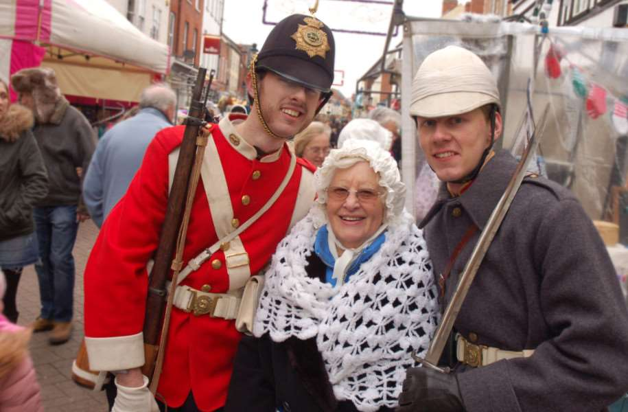 Victorian stall holder Shirley Maddex gets together with Historic Re-enactors Jed Jaggard and Adam Cockerill. Photos: Tim Williams.
