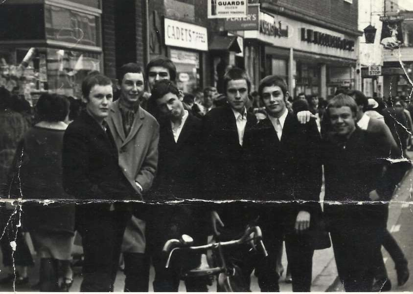 Picture of Grantham mods on the High Street outside the old Journal office in 1966 . Left to right are Andrew Hutchinson, Norman Kirk, David Pick (deceased) , Frank Lepora, Robb Lambley, Terry Serle and Richard Garret (deceased).
