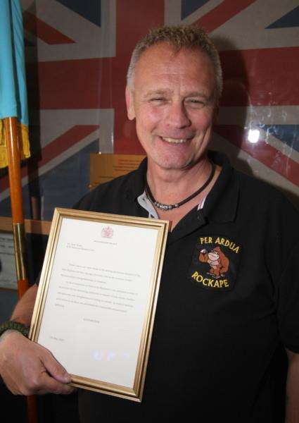 Dean Ward with his letter from the Queen EMN-150519-145043001