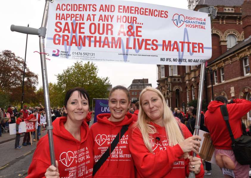 Sarah Stock is pictured on the left at Saturday's protest through Grantham. Also pictured are Melissa Darcey and Jody Clark. EMN-161029-180346009