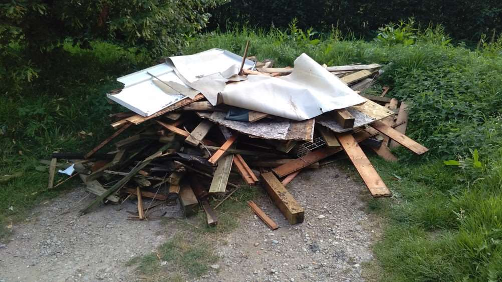 Old timber and other items left by fly-tippers at Londonthorpe Wood.