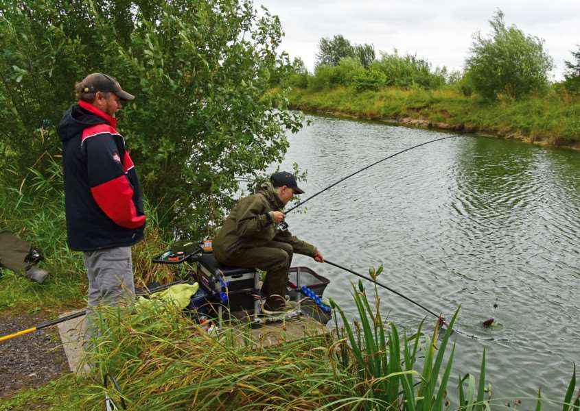 Toot Hill's Great Rod Race: Rob Perkins looks on as Josh Butlin-Sirrs lands a Portland carp.