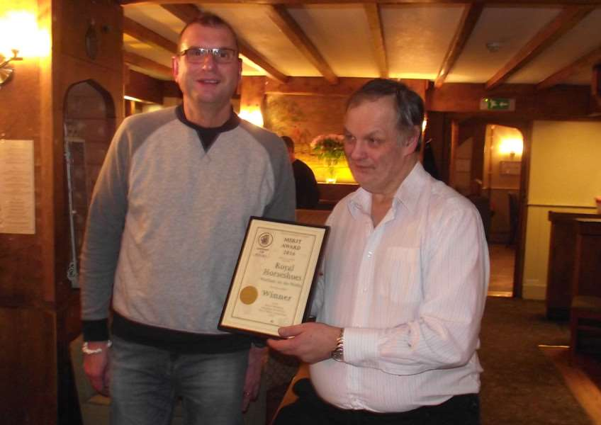 Melton CAMRA chaiman Kevin Billson presents a Merit Award to landlord Mick Nicklinson for the quality of his cask ales at the Royal Horseshoes, at Waltham EMN-161114-162040001
