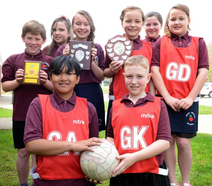 Isaac Newton Primary School netball team are, from left, back - Dudley Llewellyn-Bowatel, Julia Zbacka, Abigail Robinson, Brooke Hull, Danielle Webb and Faye Taylor; front - Luke Luiz and Kian Dolby. Photo: Toby Roberts