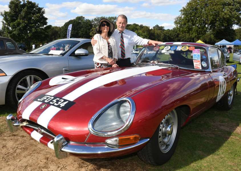 Jaguar Enthusiasts Club classic car show at Woodland Waters. Malvin Ward and Christobel Christopher of Ruskington, with their 1961 Jaguar E Type. EMN-160915-160026001