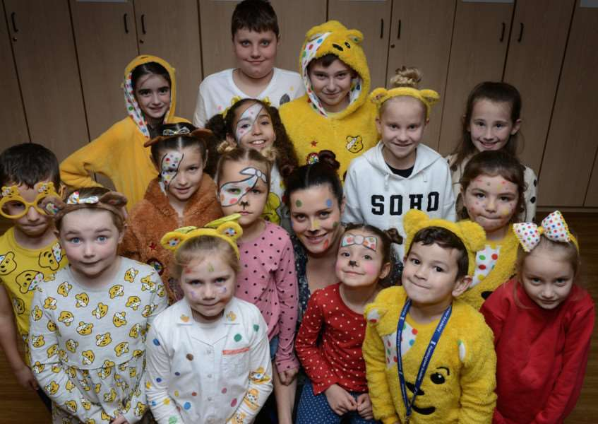 Huntingtower Primary Academy pupils dressed up as Pudsey bear to raise �482.82