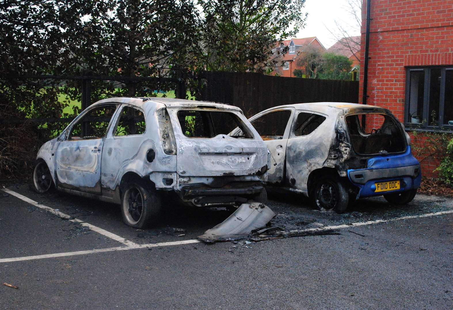 Residents fear what will happen next after arson attack destroys two cars outside flats