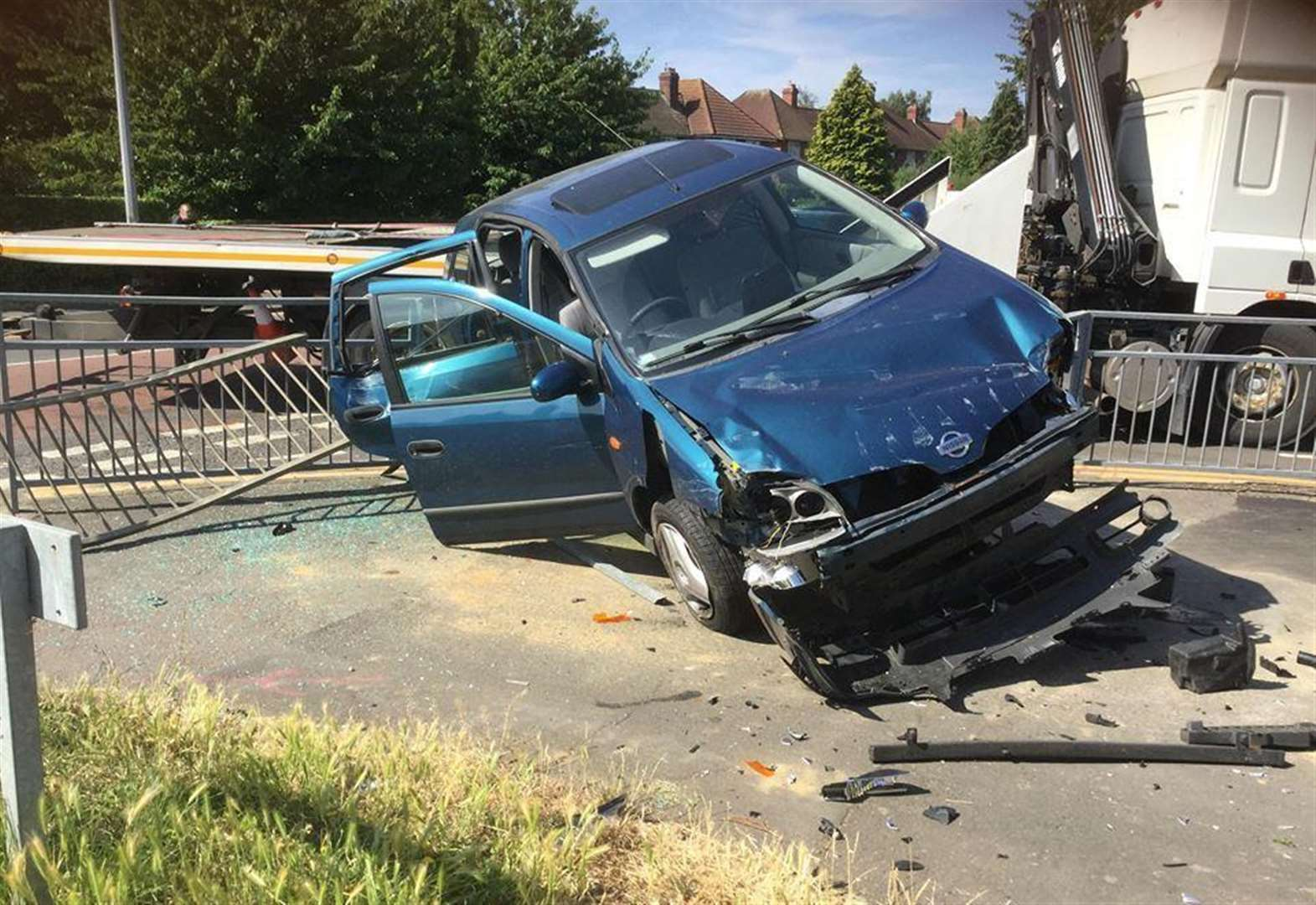 Update: Car ploughs through railings after two vehicle crash in Grantham