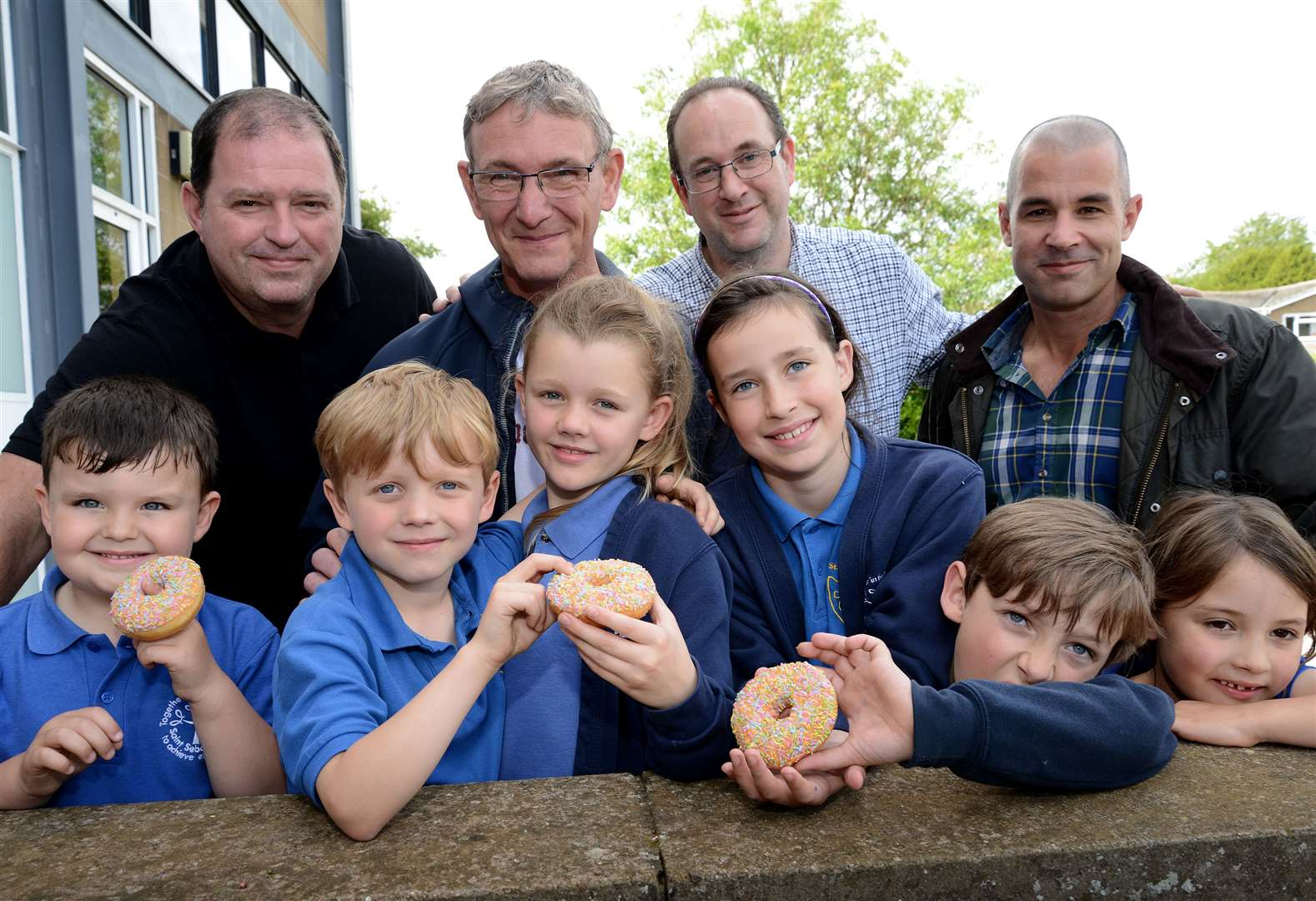 School treats their dads to donuts for Father's Day