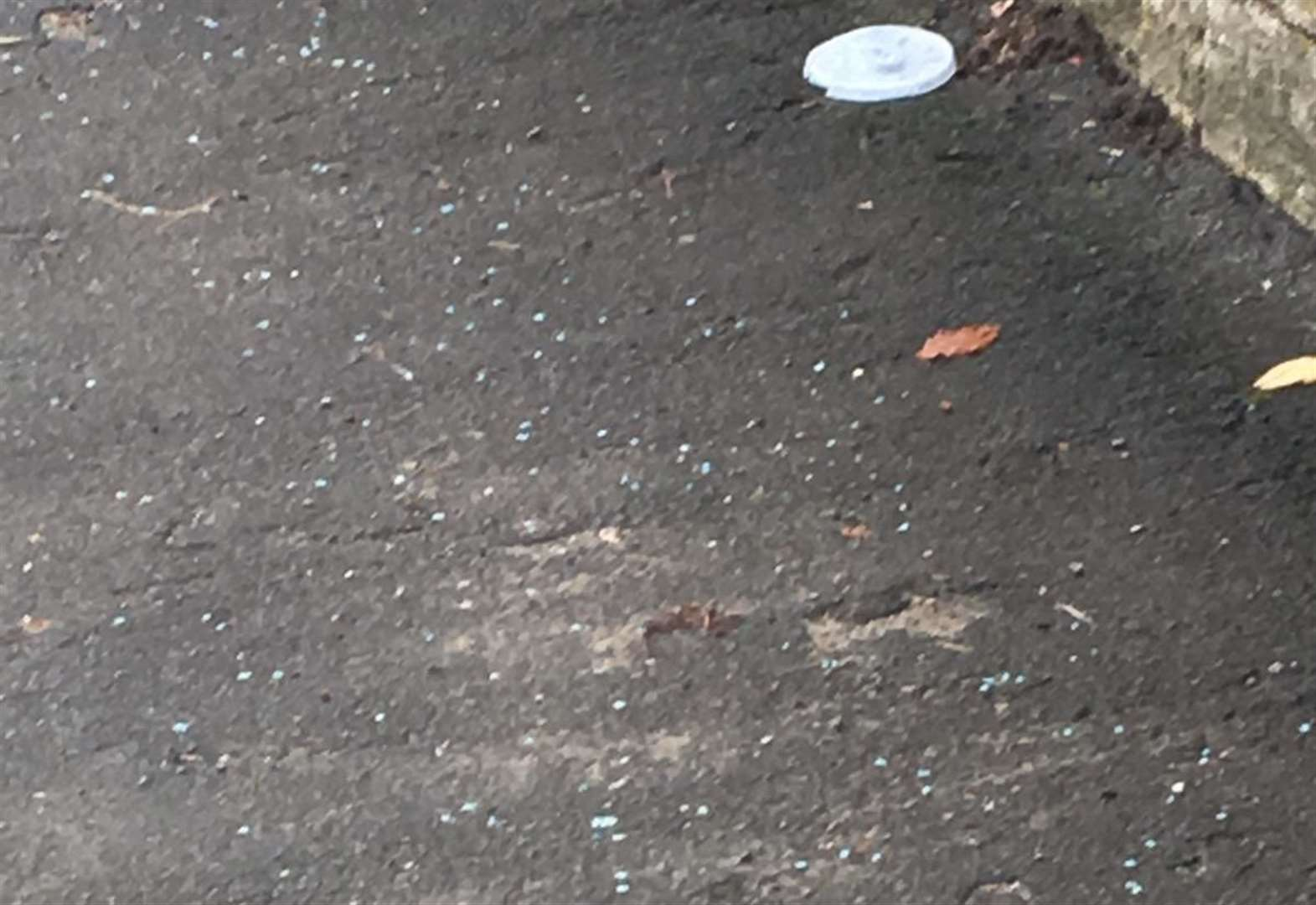 Residents raise fears over 'blue pellets' on pavements