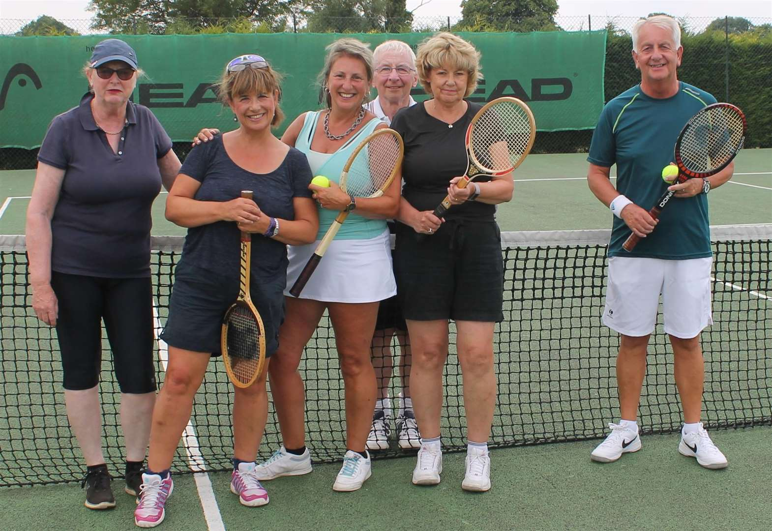 Belvoir tennis players dig out wooden racquets for tournament.