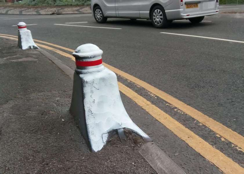 Bollards on the junction of Sankt Augustin Way and Barrowby Road have been painted white and topped with red tape.