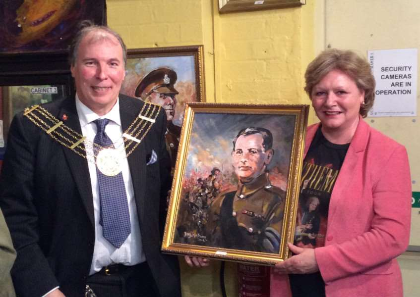 Mayor of Grantham Ian Selby and Christine Jenkinson who bought this Terry Shelbourne painting of Charles Sharpe VC.