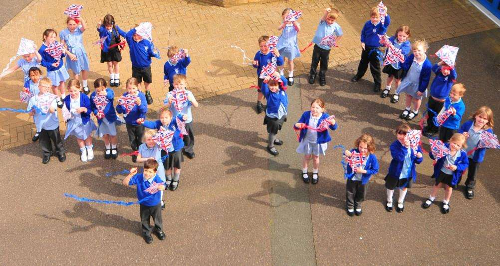 Children at Barkston and Syston Primary School with their Union Jack kites spell out '90' for the Queen's birthday.