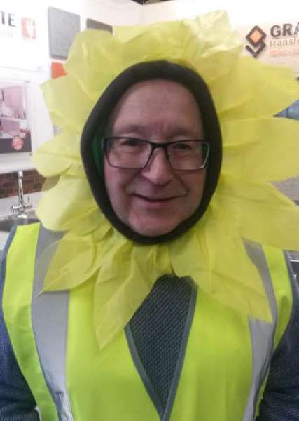 Secretary Jon Bishop gets into the Sunflower Challenge spirit.