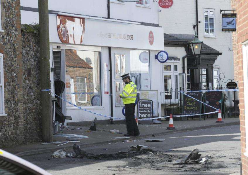 Police on scene at the One Stop Store in Feltwell following the raid during the early hours of Monday, April 16