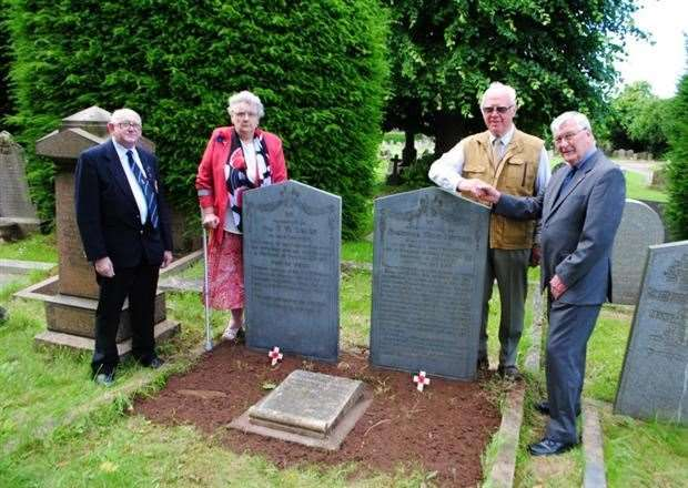 The refurbished gravestones of Richard Wish Lutpon and Sgt H. W. Eglen. Pictured with the stones are, from left, John and Grace Knightall, Peter Cole, of G. H. Linnell and Coun Mike Cook. (7621323)