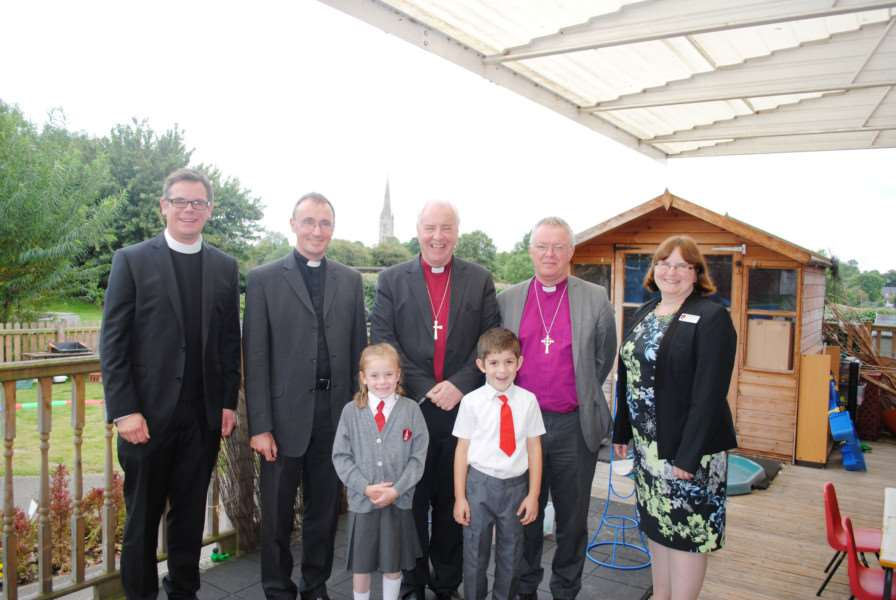 The new Bishop of Grantham, the Rt Rev Dr Nicholas Alan Chamberlain, second from left, is pictured at Little Gonerby School with from left, Rector of Grantham Fr Stuart Cradduck, the Bishop of Lincoln the Rt Rev Christopher Lowson, the Bishop of Grimsby, the Rt Rev David Court, and headteacher Helen Hilton. Pupils are Amelia Bennett, 6, and Joshua Gallaher, 6.