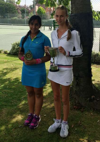 Angela Halton (right) with the girls' singles winner's trophy at Boston.