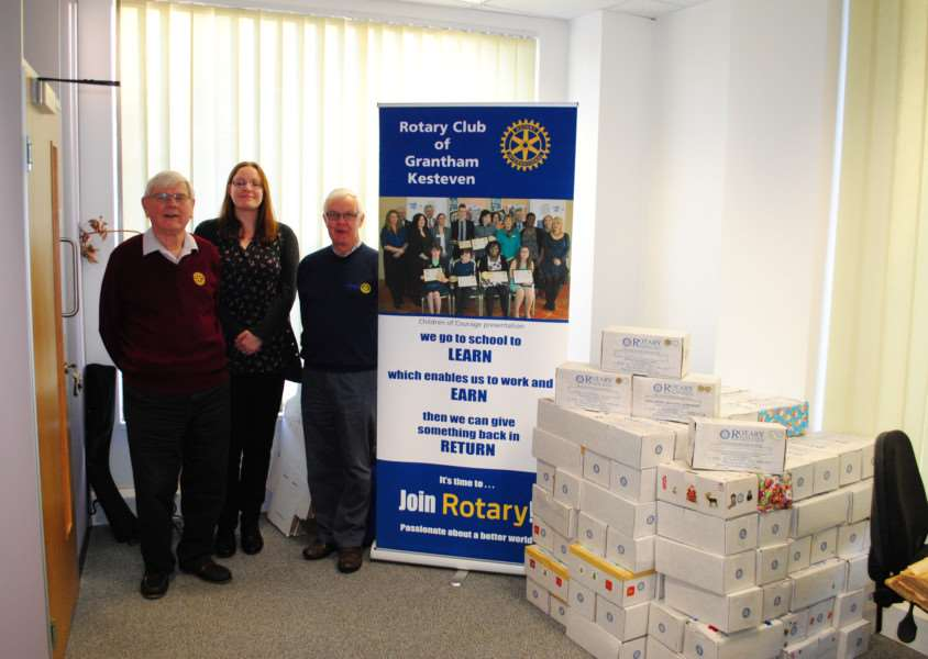 With the collection of shoeboxes are from left, Tony Griffin, of the Rotary Club of Grantham Kesteven, Grantham Journal Deputy Editor Marie Bond and Rotary President Chris Thurlow.