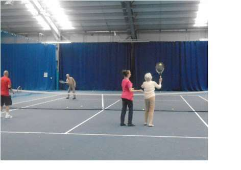 Avery Lodge residents play tennis.