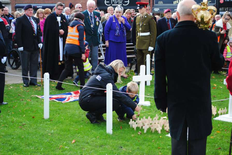 Collecting the crosses in St Peter's Hill on Armistice Day.