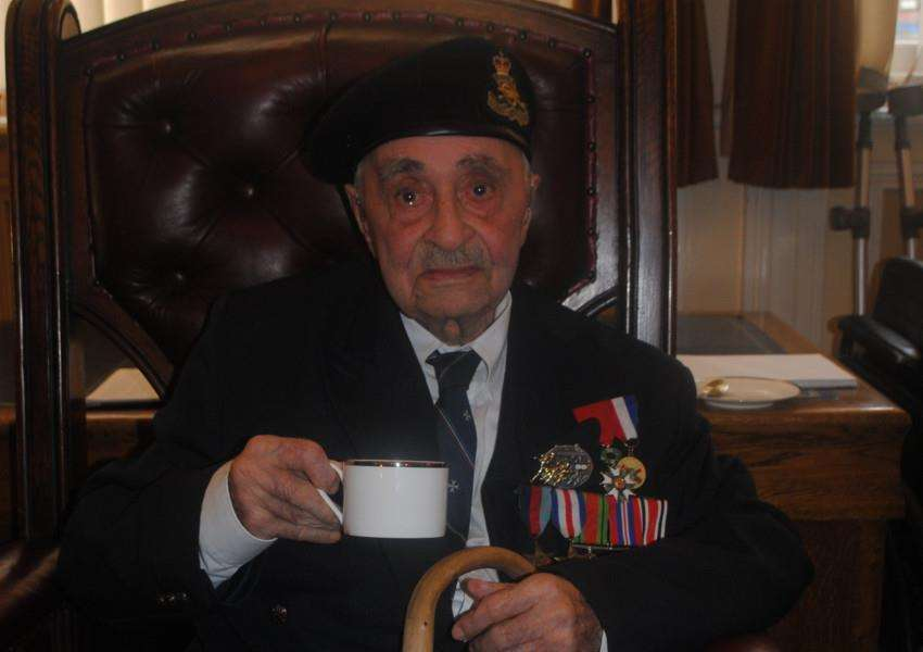 Walter Partridge with his medals and a cuppa.