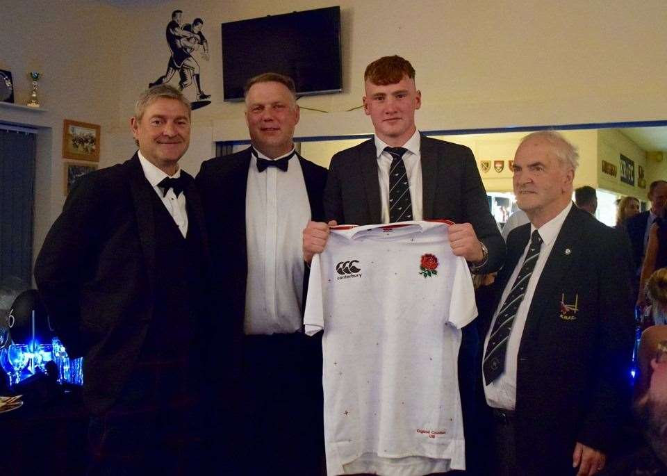 Ollie Chessum with his England Under-18 jersey, club president Angus Shaw, coach Andrew Singer and secretary Bill Berridge. (10878621)