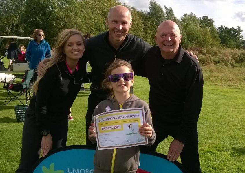Brownie Sophie Legard at the golf day at Belton Woods with from left, Stacey Mitchell, Iain Fulton and Ken Claxon.