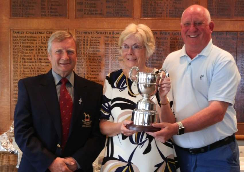 Belton Park captain Derek Bashford presenting the Freda Shipley Trophy to winners Jean Sutcliffe and Ged O'Reilly.