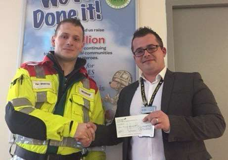 Jay (pictured left), receiving the cheque from Moto North area general manager Leon Scott.