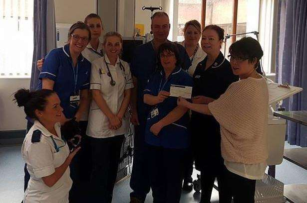 Nurses at Lincoln hospital receive the cheque.