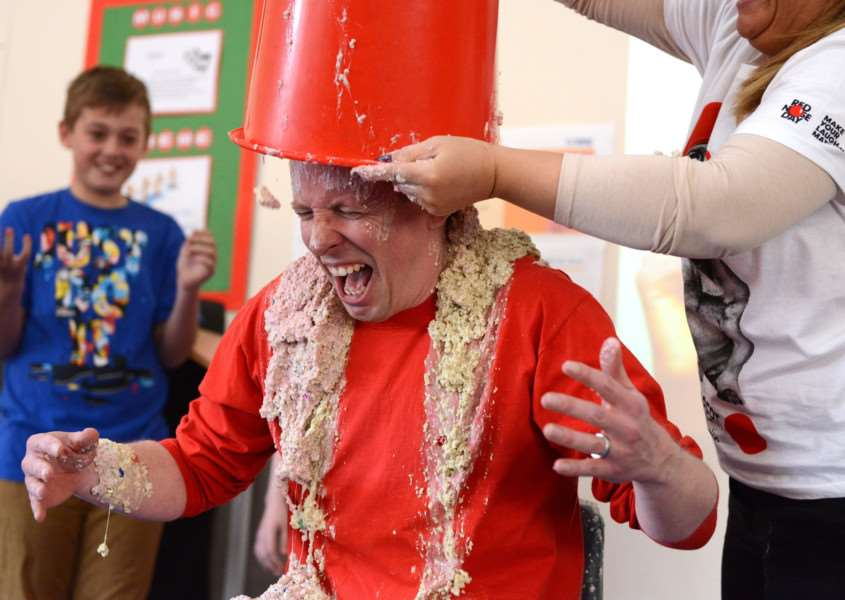 Paul Hill, headteacher at Isaac Newton Primary School in Grantham, gets gunged on Red Nose Day.
