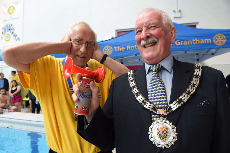 Rotarian Andrew Redman takes no chances as SKDC chairman Bob Sampson gets the Swimarathon started.
