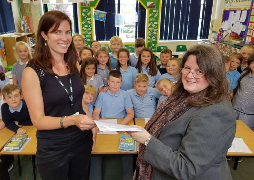 Teacher Victoria Atter presents Belton Lane Primary School letters to Coun Charmaine Morgan, chair of SOS Grantham Hospital.