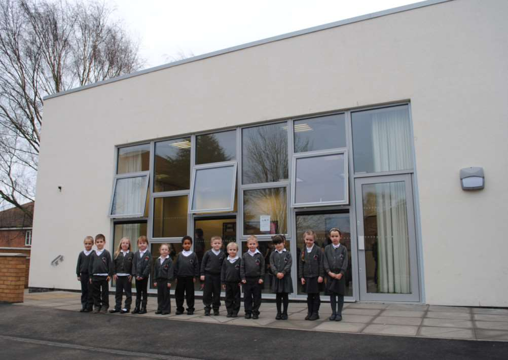 Youngsters at Isaac Newton School are enjoying their new classrooms on site. They are pictured in front of the new studio.