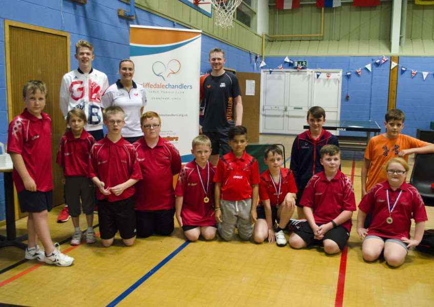 Tom Jarvis, Kelly Sibley and Gavin Evans with some members of Cliffedale Chandlers Table Tennis Club. Photo: Nix Pix UK