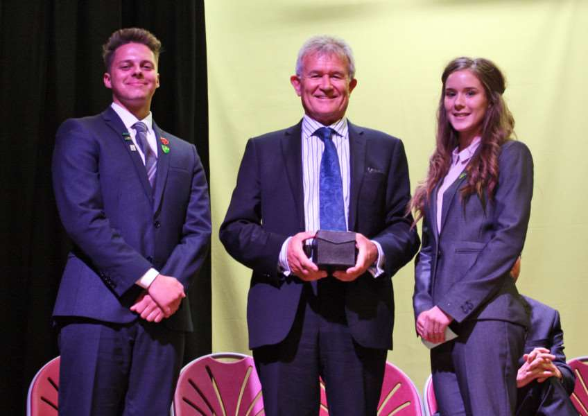 Head Boy Samuel Rose and Head Girl Samantha Bradley present Frank Green CBE with a gift of thanks as part of The Priory Ruskin Academy official opening.