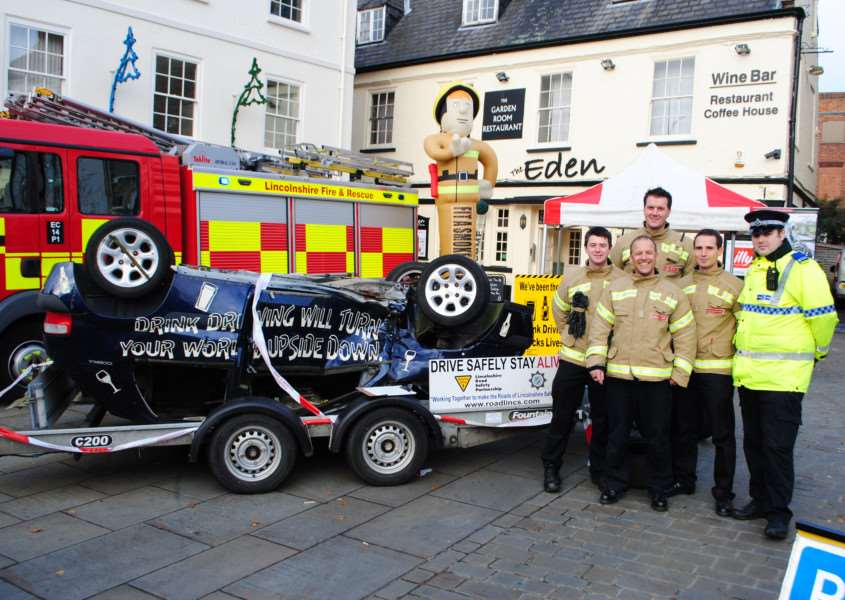 Christmas road safety campaign. Pictured are: Stephen Waters, Blue Watch crew manager Peter Lake, Keith Farr, PCSO Dan Widdowson and Darren Richmond (front).