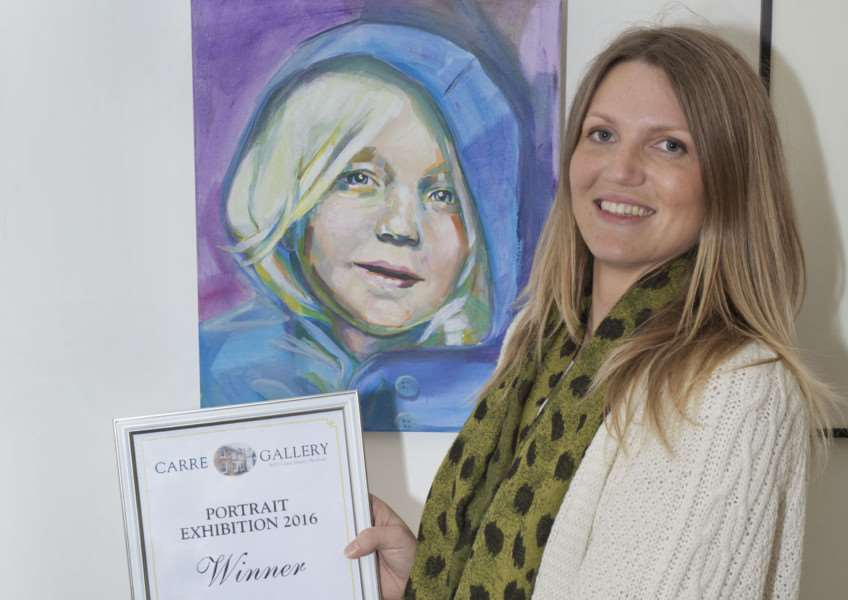 Winner of the Carre Gallery Portrait Competition 2016, Rebecca Henson with her painting 'Lara' Copyright Martin Cameron EMN-161013-094605001 EMN-161013-094605001