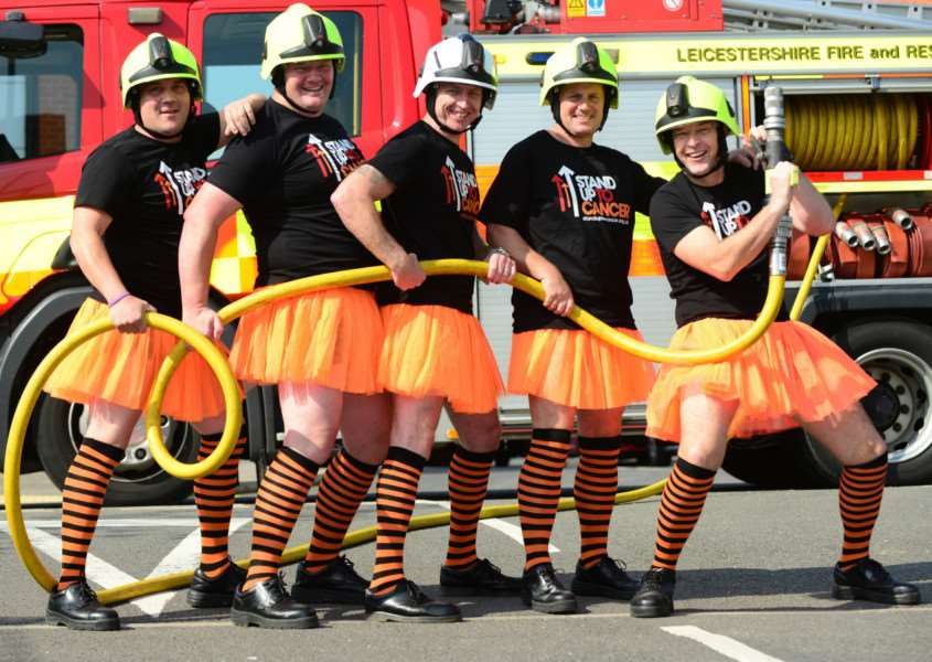 These firefighters wearing their orange tutus, stripy socks and T-shirts in support of Stand Up To Cancer include Melton man, Nick Spargo, pictured second from the left EMN-150110-140754001